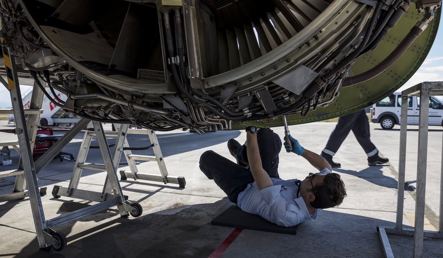 Aircraft mechanic repairs engine of airplane Boeing 737-800 . Airplane maintenance. Aircraft technician.