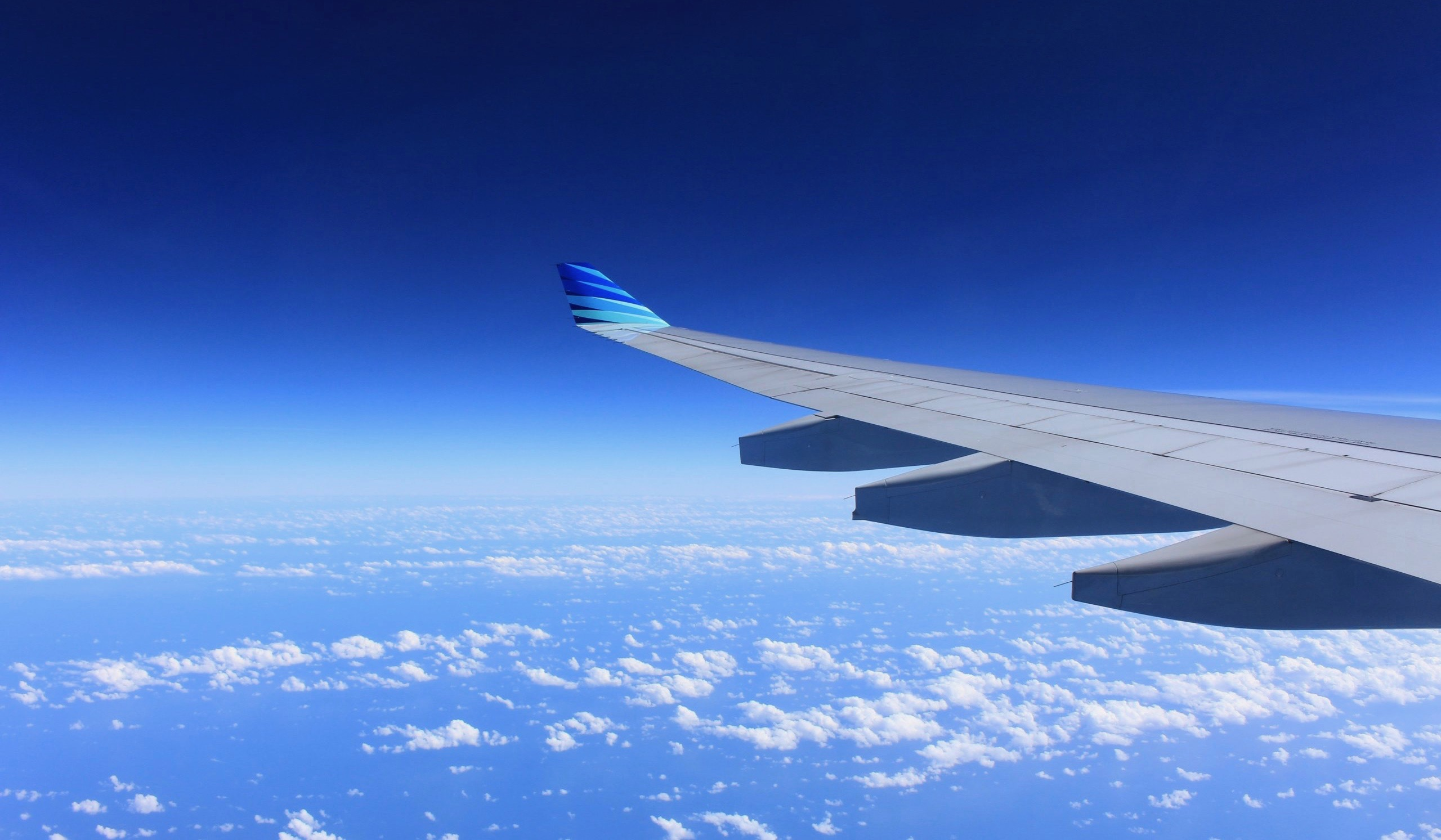 airplane wing in blue sky