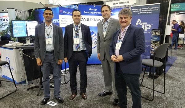 Atp employees standing near booth at conference