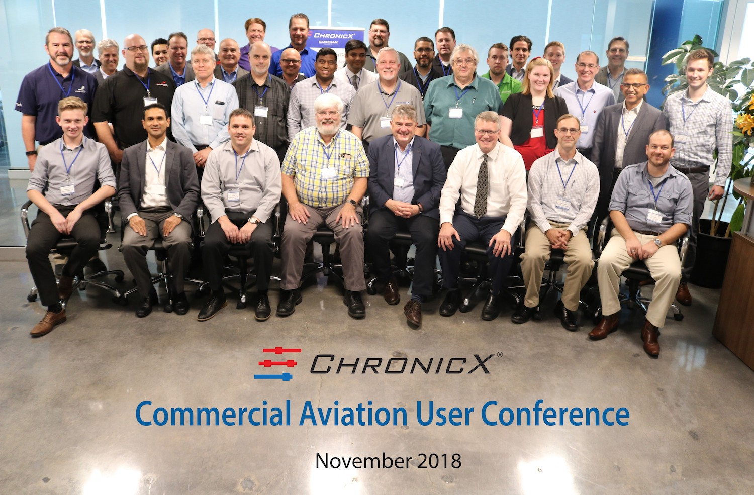 Group of people from commercial aviation user conference sitting and looking at camera