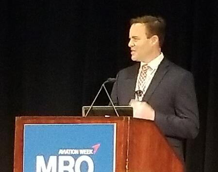 male speaker on stage at MRO conference